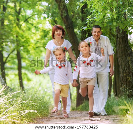 Happy family on the walk in park
