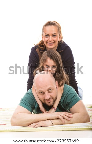 Happy family on top each other  against white background