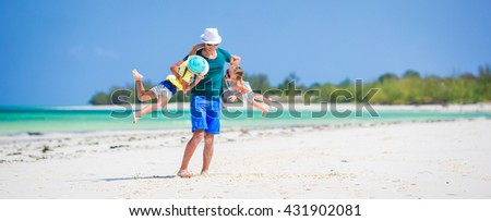 Happy family on tropical beach having fun together