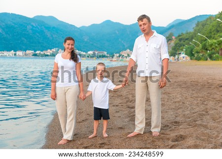 happy family on vacation near the sea - stock photo