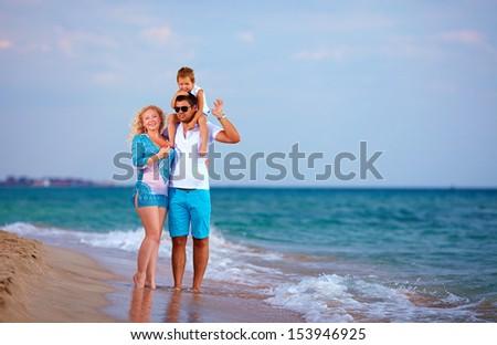 happy family on vacation, sea beach - stock photo