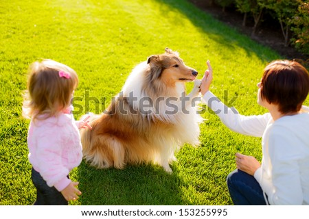 happy family on walk trained dog - stock photo