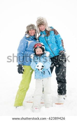 Happy family on winter vacation (snow storm)
