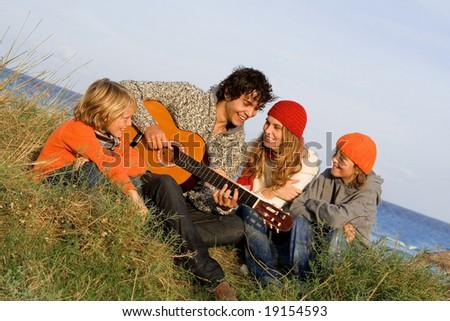 happy family on winter vacations - stock photo