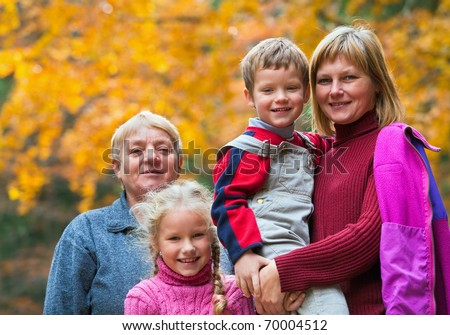 Happy family outdoor portrait in a autumn mountain walk