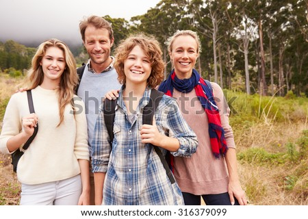 Happy family outdoor portrait in a forest - stock photo