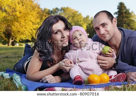 happy family outdoors - stock photo