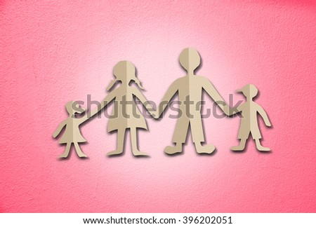 Happy family paper cut on cement wall background - stock photo