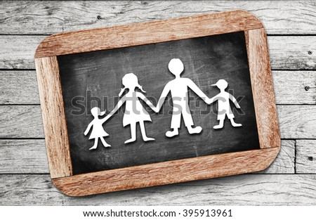Happy family paper cut on chalkboard background - stock photo