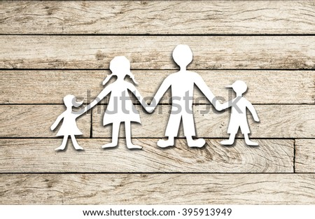 Happy family paper cut on wood background - stock photo