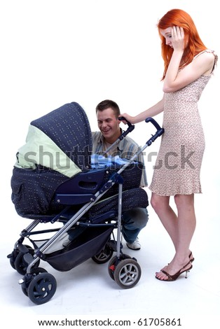 happy family - parents with baby stroller - stock photo
