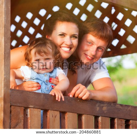 Happy family photo in bower - stock photo