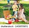 Happy family picnicking - stock photo