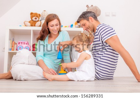 happy family playful with little daughter - stock photo