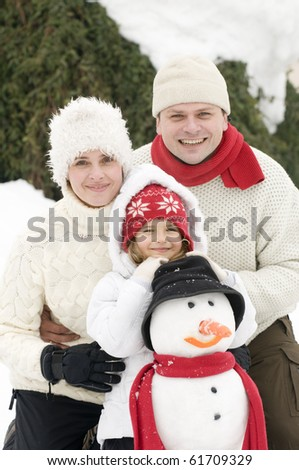 Happy family playing at Christmas time - stock photo