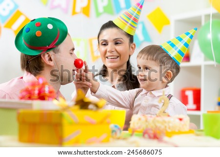 happy family playing game on child birthday - stock photo