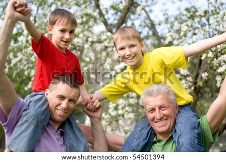 happy family playing in a summer park