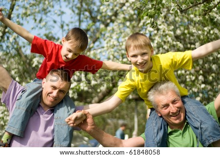 happy family playing in a summer park - stock photo