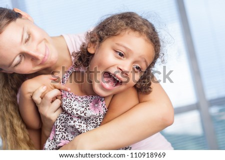 Happy family playing indoor - stock photo