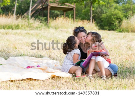 happy family playing on the wheat at park, outdoor portrait - stock photo