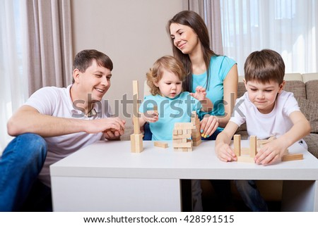 Happy family playing together at home.