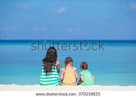 Happy family playing with beach toys on tropical vacation