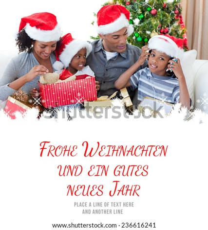 Happy family playing with Christmas presents against frohe weihnachten message - stock photo