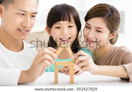 happy family playing with toy blocks - stock photo