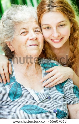Happy family portrait - daughter and grandmother outdoor - stock photo