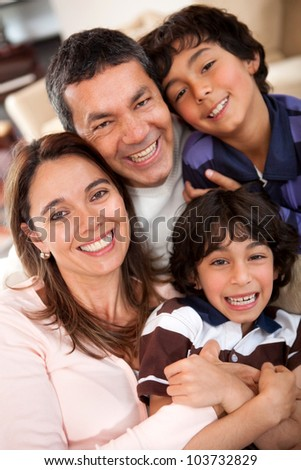 Happy family portrait enjoying time together at home - stock photo