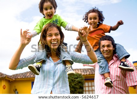 happy family portrait having fun outdoors at their home - stock photo