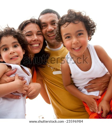 happy family portrait having fun outdoors during a holiday - stock photo
