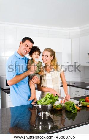 happy family portrait in home kitchen - stock photo
