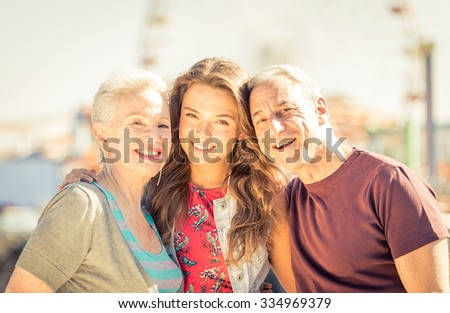Happy family portrait in Santa monica, Los angeles - stock photo