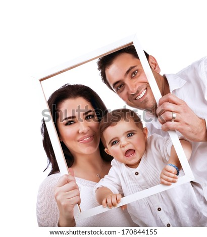 Happy family portrait isolated on white background, holding in hands frame, nice picture of adorable baby girl with parents - stock photo