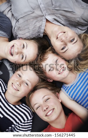 Happy family portrait of mother and four siblings - stock photo