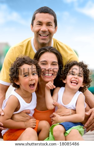 happy family portrait outdoors during a holiday - togetherness concept - stock photo