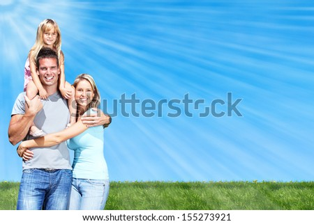 Happy family portrait over blue sky background. - stock photo