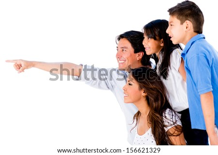 Happy family portrait pointing away - isolated over a white background  - stock photo