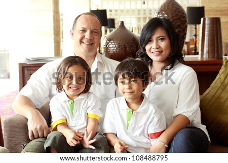 happy family portrait smiling to the camera - stock photo