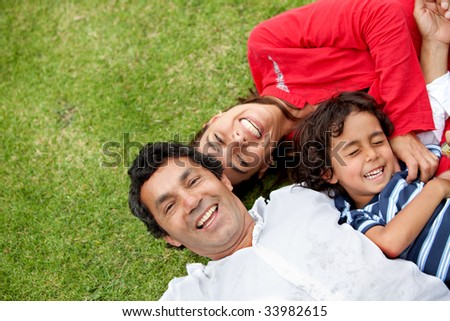 happy family portrait standing outdoors smiling - stock photo