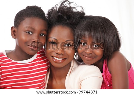 Happy family portrait with mom and two kids - stock photo