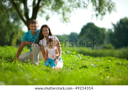 Happy Family posing together summer outdoors