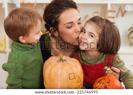 Happy family preparing for autumn holidays - stock photo