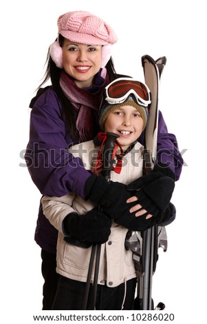 Happy family ready for a winter ski vacation or outing.