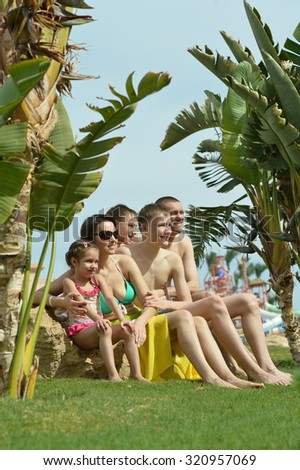 Happy family relaxing at vacation resort - stock photo