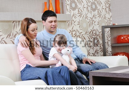 happy  family relaxing in modern livingroom at home - stock photo