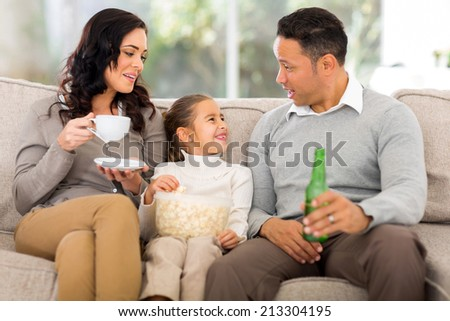 happy family relaxing on the couch at home - stock photo