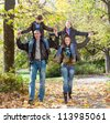 Happy family  relaxing outdoors In autumn park - stock photo