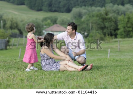 happy family relaxing outside